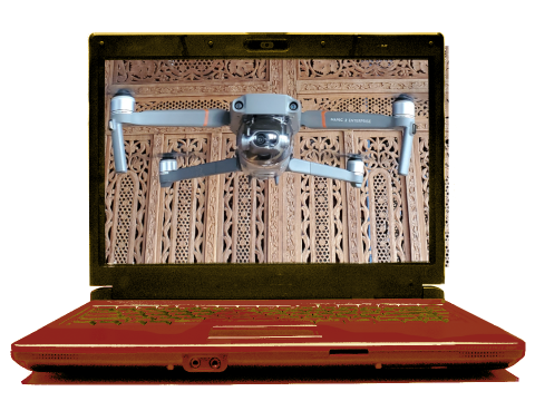 Drone flying with wooden sculptered background
